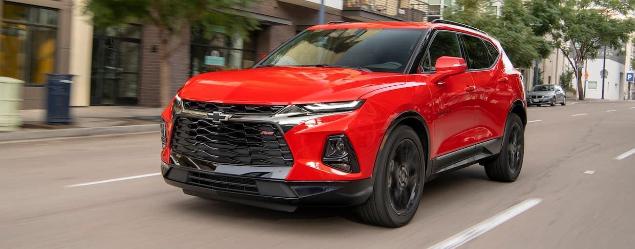 A red 2019 Chevy Blazer is driving down a Cincinnati, OH street.