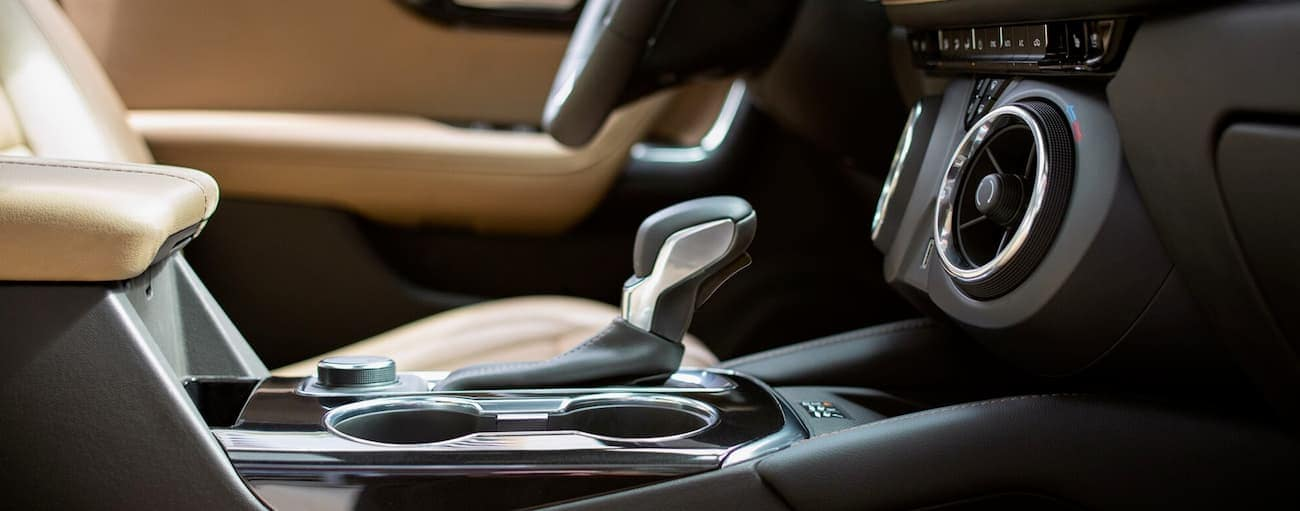 The black and tan interior of the 2019 Chevy Blazer is shown with a closeup of the shifter.
