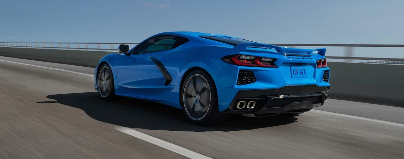 A blue 2020 Chevy Corvette Z51 is driving alone on the highway.
