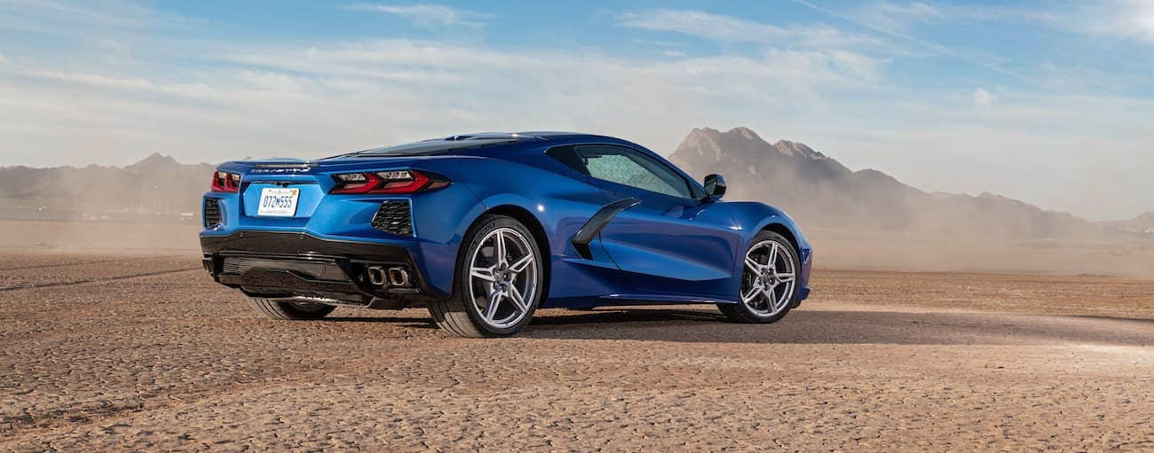 A blue 2020 Chevy Corvette 3LT is parked in the desert.