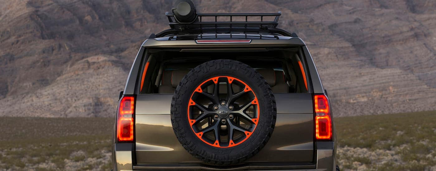 A tan Chevy Suburban, shown from the back, has aftermarket accessories for a 2017 SEMA build.