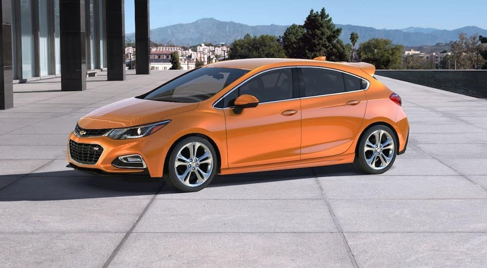 An orange 2017 Chevy Cruze, popular among cars priced under $10k, is parked in a driveway outside of Cincinnati, OH.