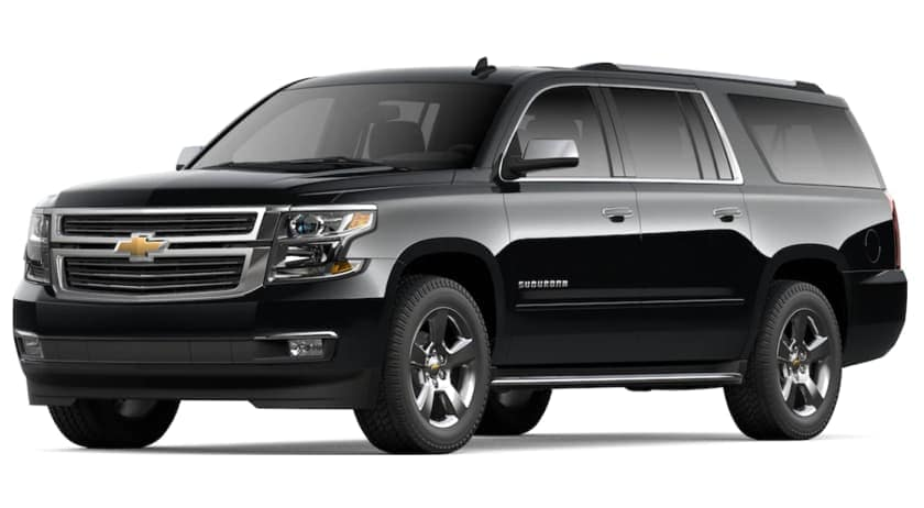 A black 2020 Chevy Suburban is facing left.