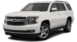 A white 2020 Chevy Tahoe is angled left.