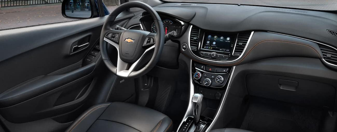 The black leather interior of a 2020 Chevy Trax is shown.