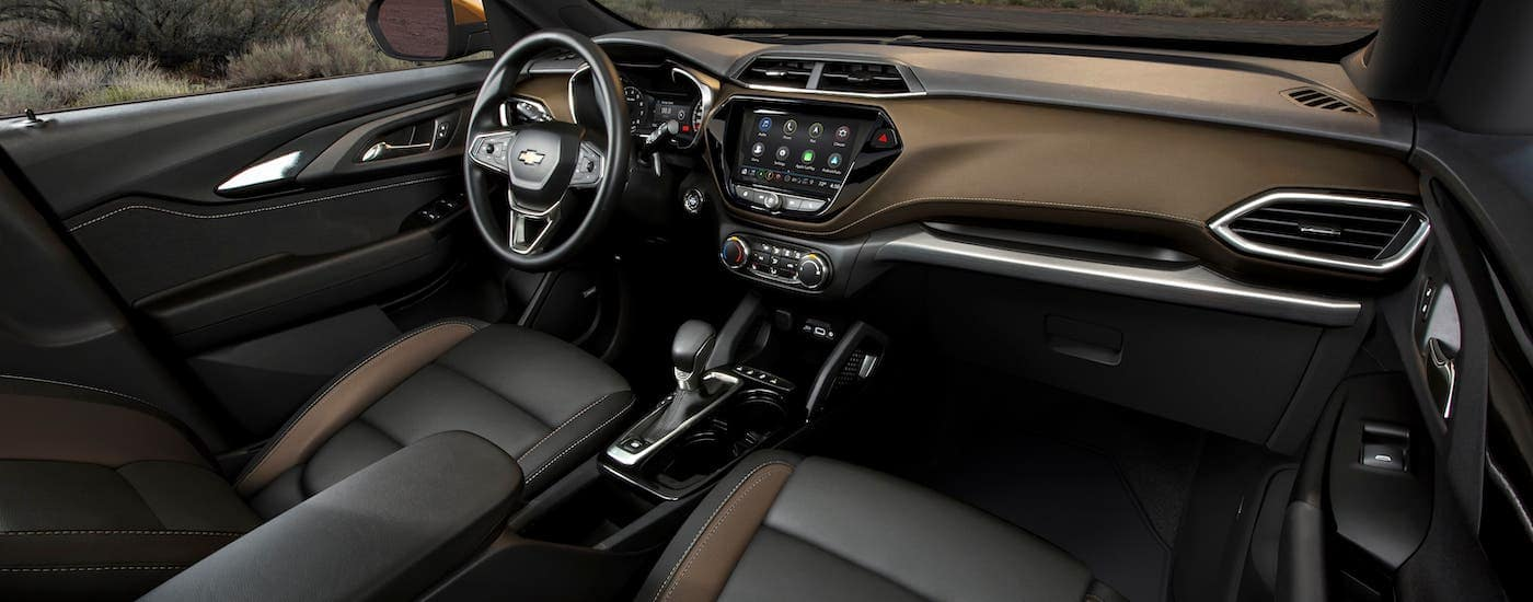 The black and gold interior of a 2021 Chevy Trailblazer is shown.