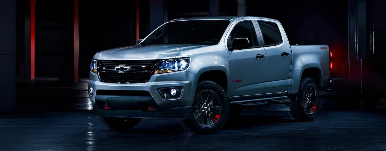 A Red Line edition 2019 Chevy Colorado is in a dark room.