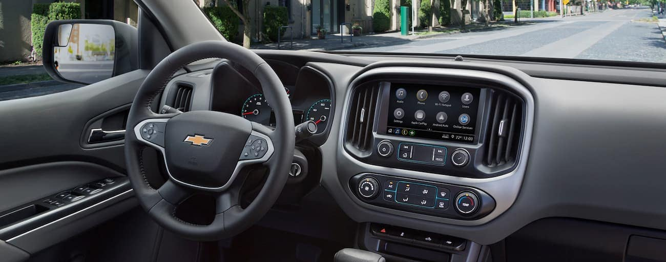 The dashboard on a 2019 Chevy Colorado is shown, with a Cincinnati, OH street in the windshield.