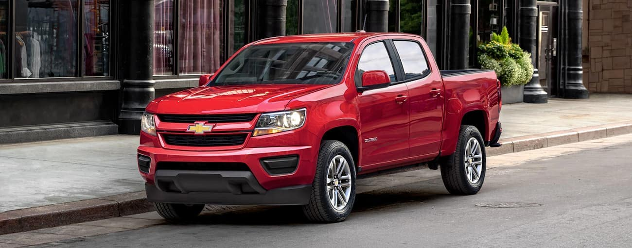 A red 2019 Chevy Colorado is on a city street.