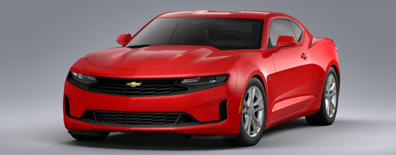 A red 2020 Chevy Camaro LS is on a grey background.