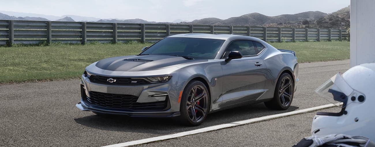 A grey 2020 Chevy Camaro SS is on a racetrack.