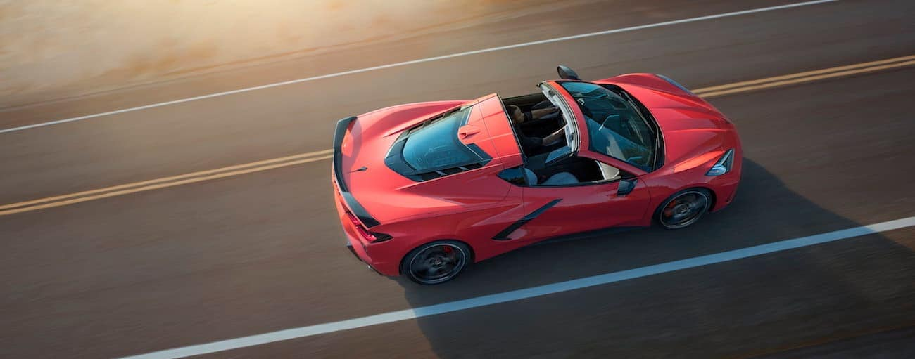 A red 2020 Chevy Corvette, which wins when comparing the 2020 Chevy Corvette vs 2019 Chevy Corvette, is shown from a birds eye view driving near Cincinnati, OH.