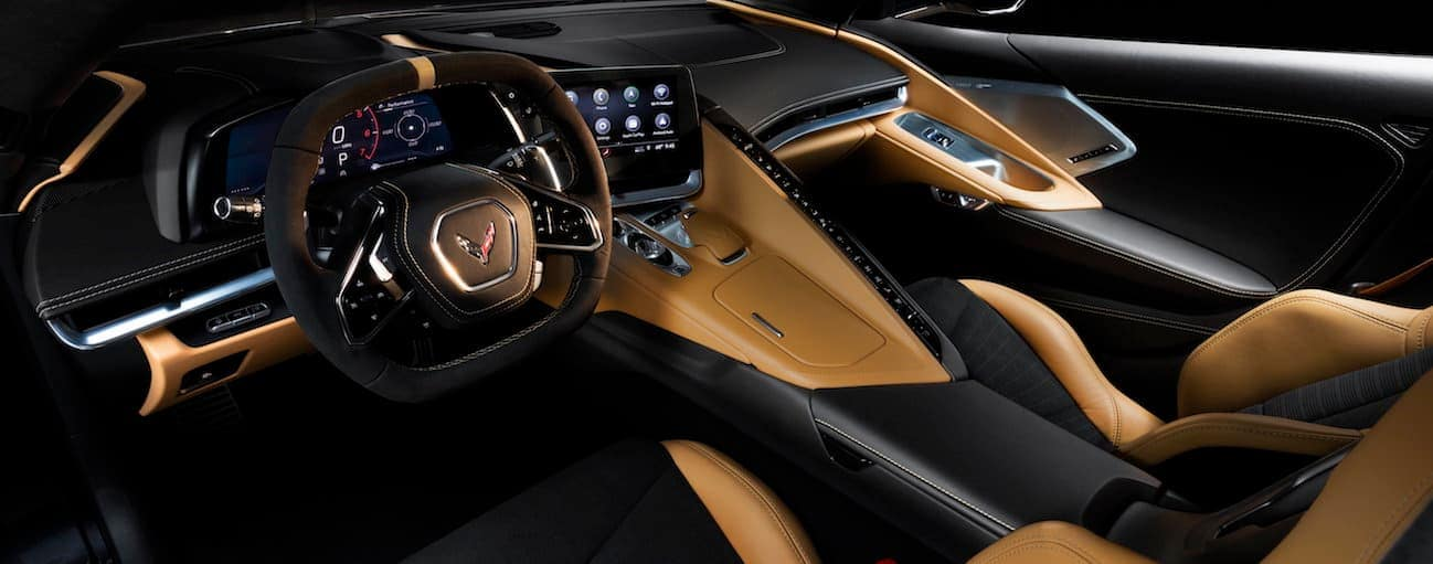 The tan and black interior of a 2020 Chevy Corvette is shown in leather.