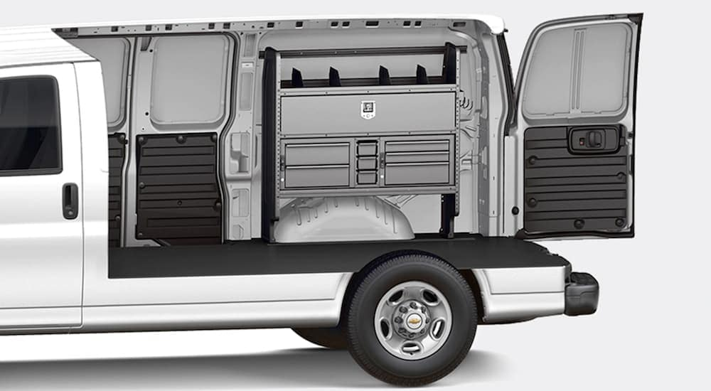 The inside of a 2020 Chevy commercial van with a toolbox setup.