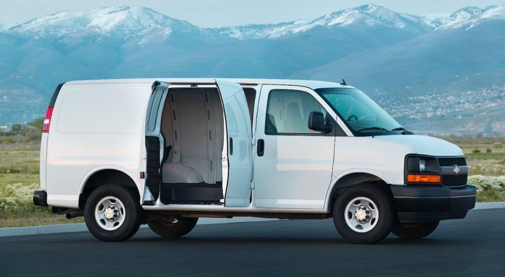 A white 2015 Chevy Commercial van, when searching what is the best commercial van in Cincinnati, OH you'll find this van, is parked in a parking lot.