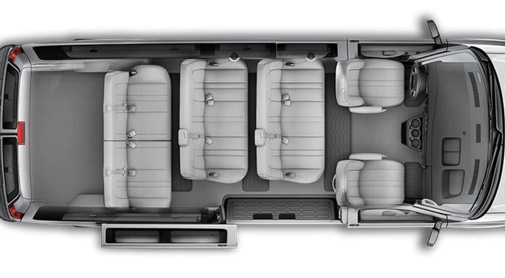 A bird's eye view of the inside seating of a Chevy passenger van is shown.