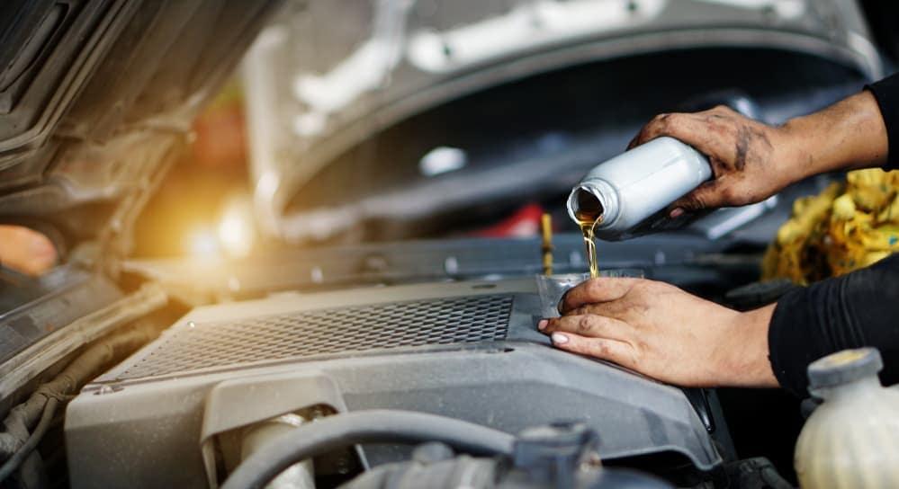 A mechanic is doing an oil change on a customers car in Cincinnati, OH.