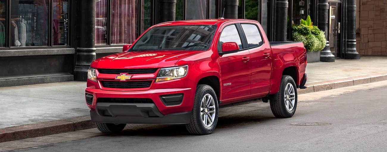 A red 2020 Chevy Colorado WT is parked on a Cincinnati, OH, street.