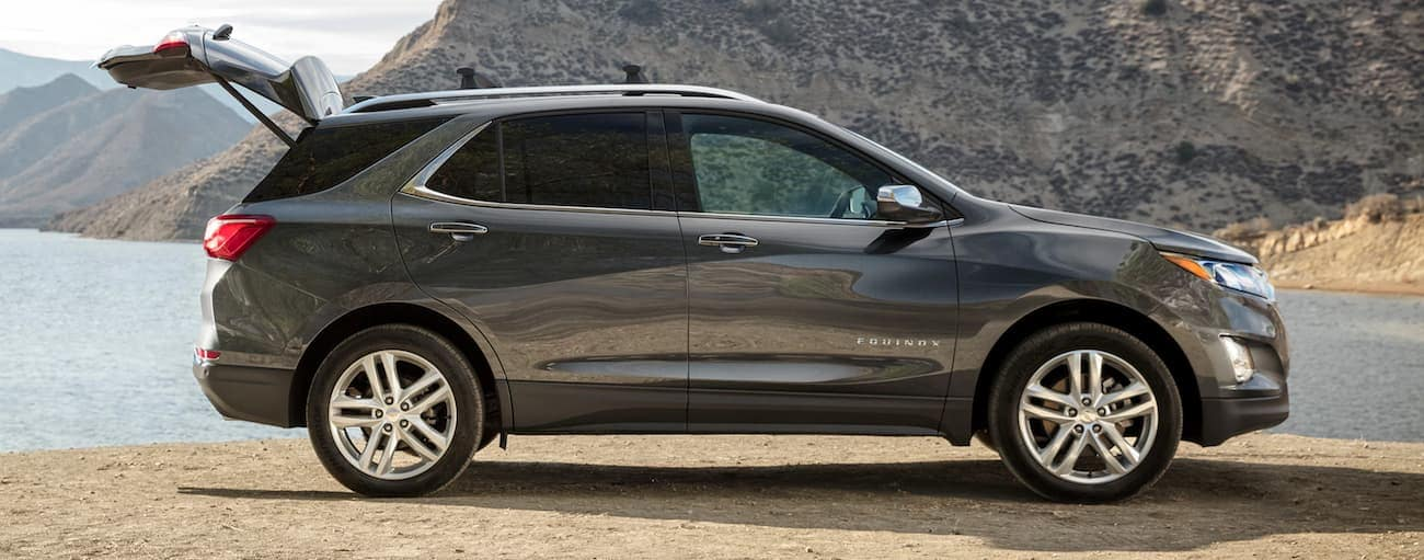 A grey 2020 Chevy Equinox LT is parked at a lake with the liftgate open.
