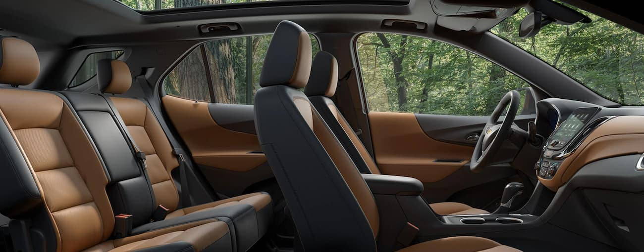A side view of the brown and black leather interior that can be found in a 2020 Chevy Equinox is shown.