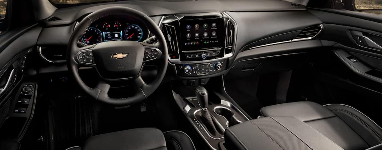 The black interior of a 2020 Chevy Traverse is shown.
