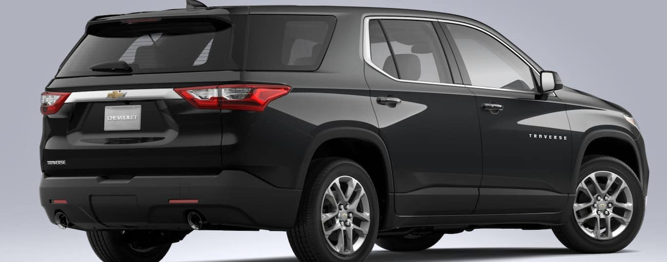 A black 2020 Chevy Traverse L is shown on a grey background from the rear.