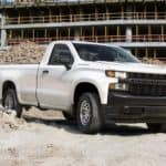 A white 2020 Chevy Silverado 1500 is parked at a construction work site near Cincinnati, OH.