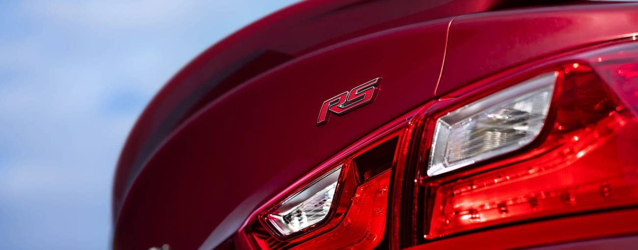 The badging on a red 2020 Chevy Malibu RS is shown in close up.