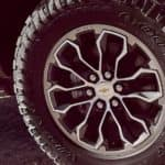 A close up of a Chevy Colorado's off-road tire and wheel is shown.
