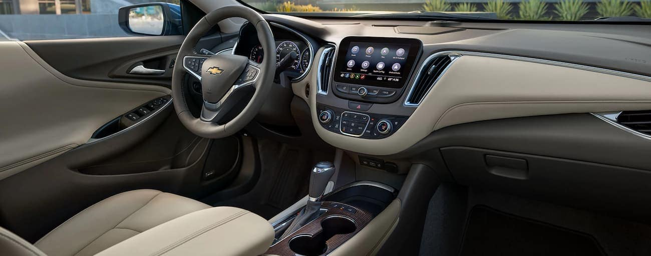 The grey and tan leather interior of a 2020 Chevy Malibu is shown.