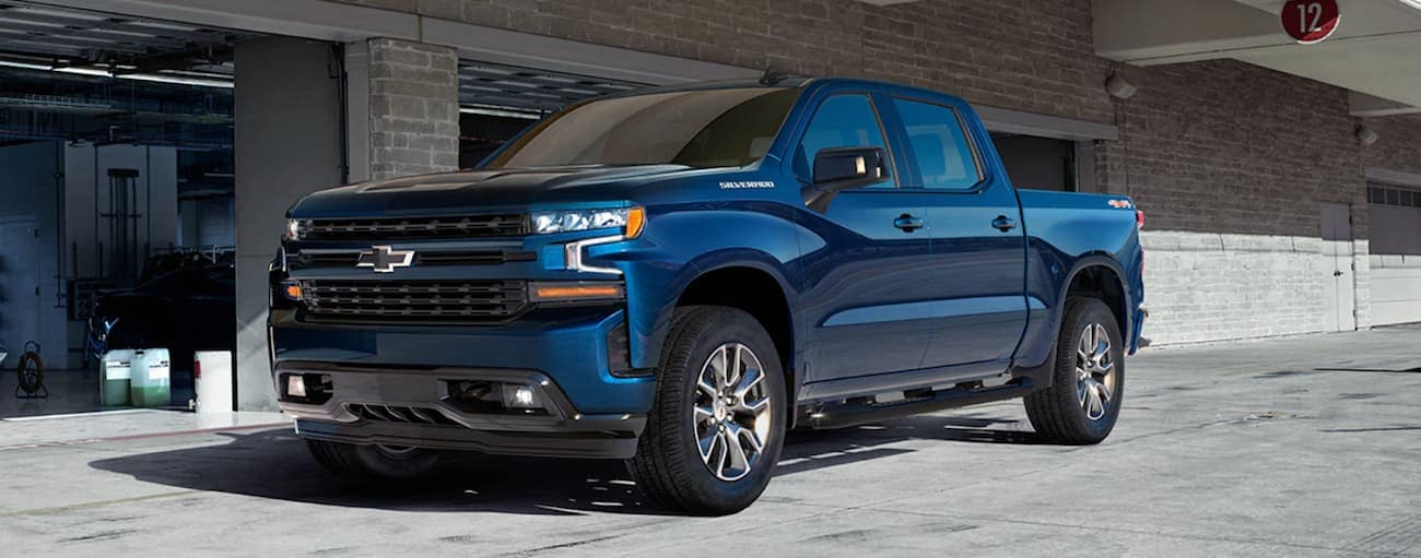 A blue 2020 Chevy Silverado 1500 is parked in front of a garage near Cincinnati, OH.