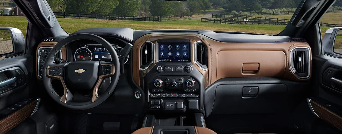 The black and brown dashboard of the 2020 Chevy Silverado is shown.