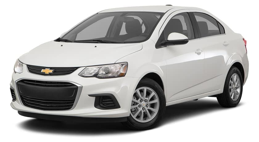 A white 2020 Chevy Sonic is facing left.