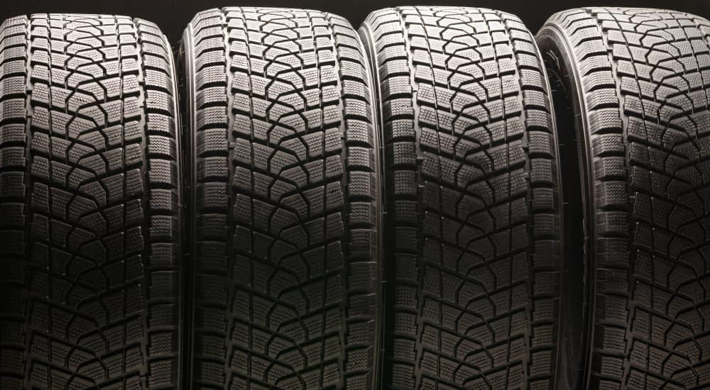 A row of four tires is shown.