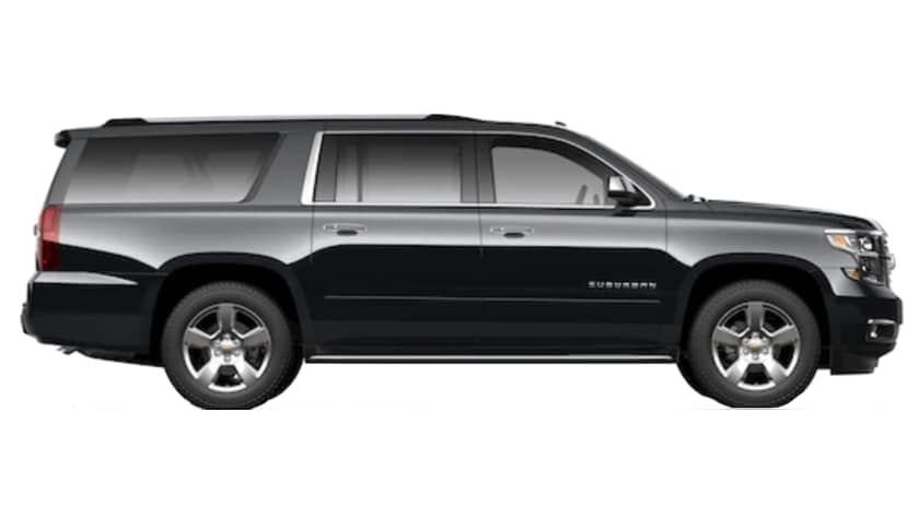 A black 2021 Chevy Suburban is facing right.