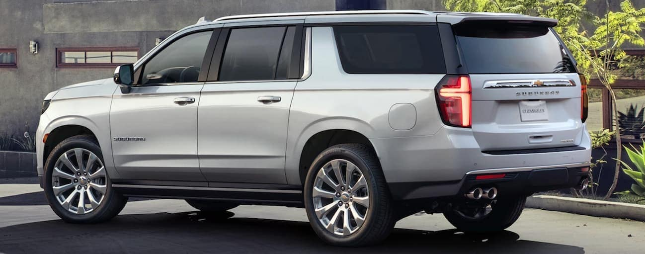 A silver 2021 Chevy Suburban is parked in front of a home near Cincinnati, OH.