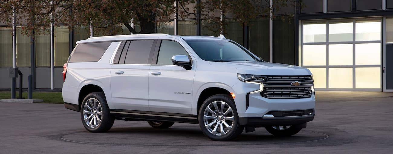 A white 2021 Chevy Suburban is parked in front of a Cincinnati, OH, office building.
