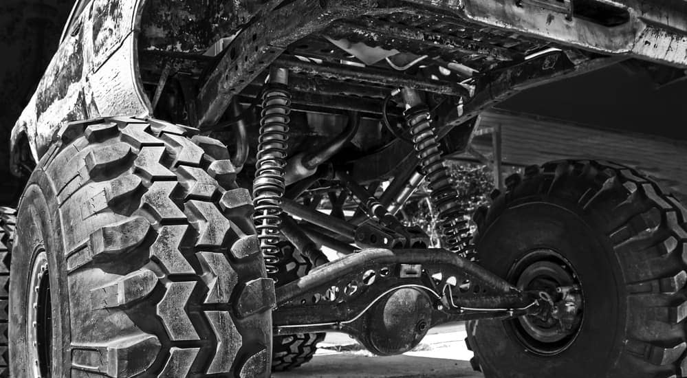 A close up of the under carriage of a monster truck.