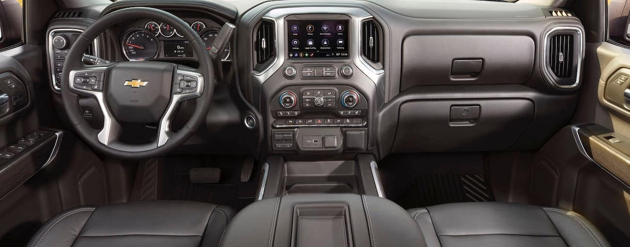 The black dashboard and infotainment features of a  2020 Chevy Silverado are shown.