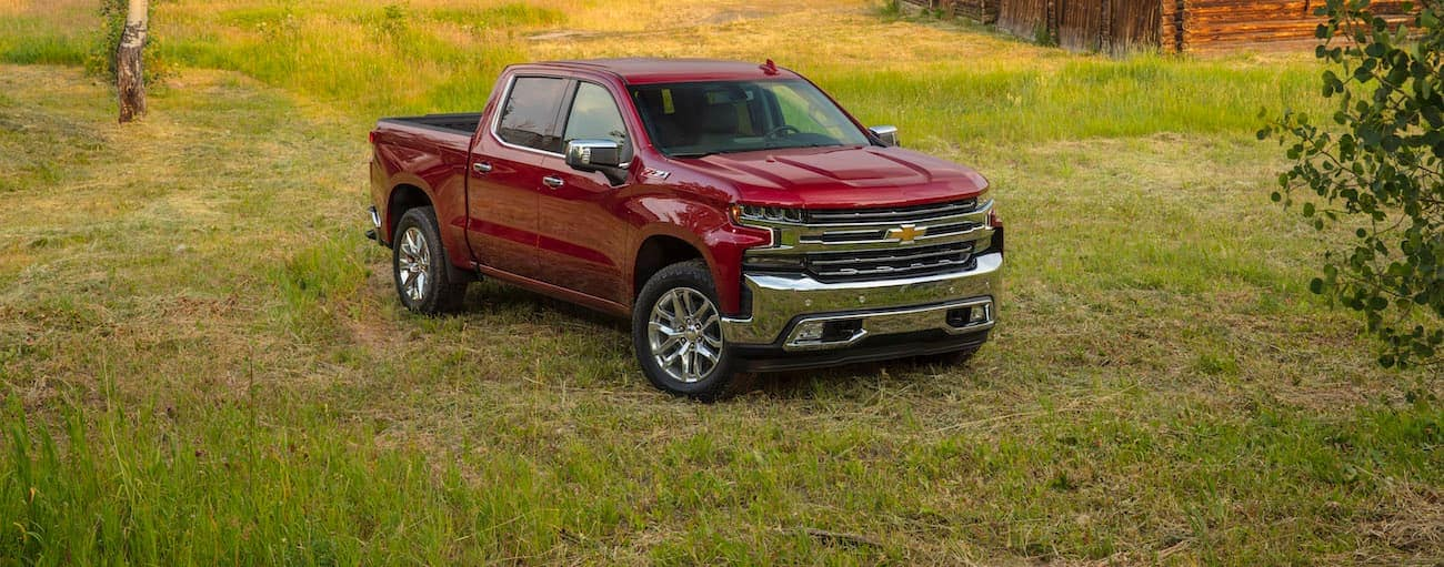 A red 2020 Chevy Silverado is parked in a field.