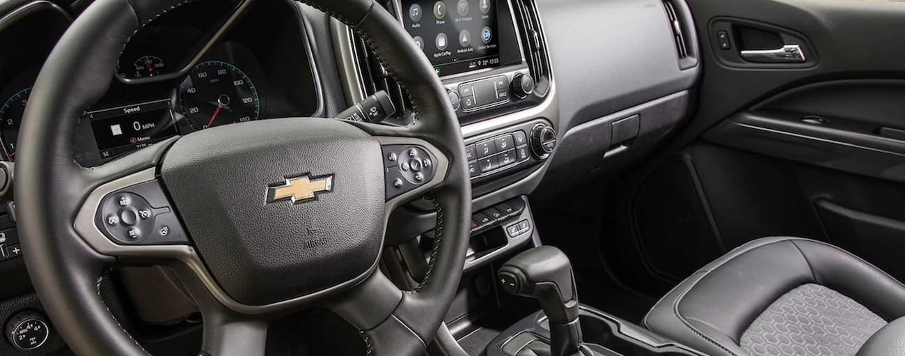 The black interior of a 2020 Colorado is shown, which may be similar to the 2021 Chevy Colorado.