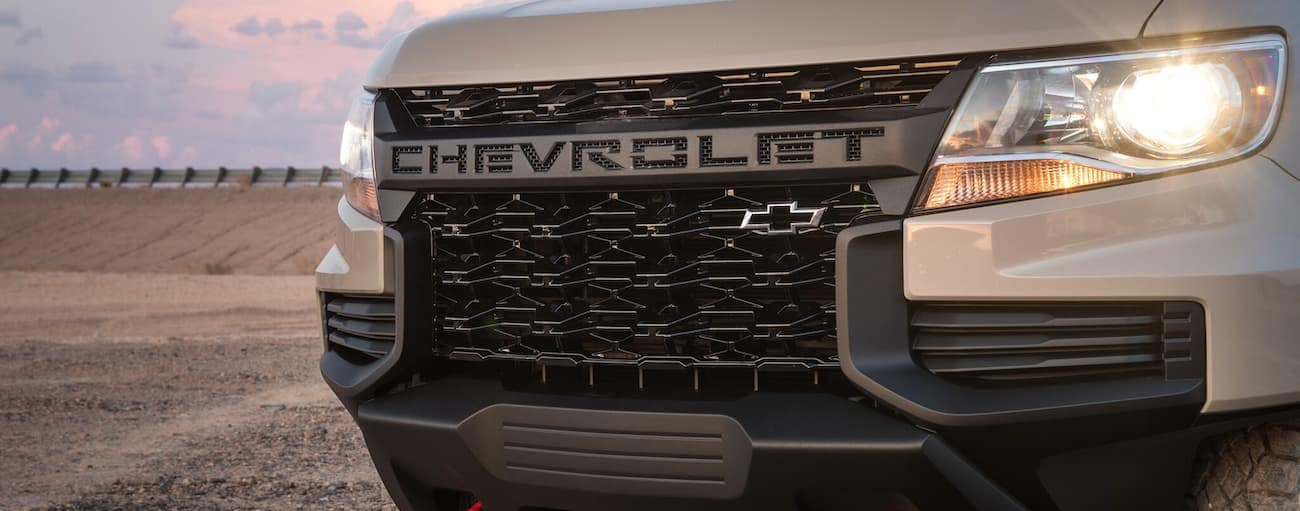 The grille of a tan 2021 Chevy Colorado is shown.