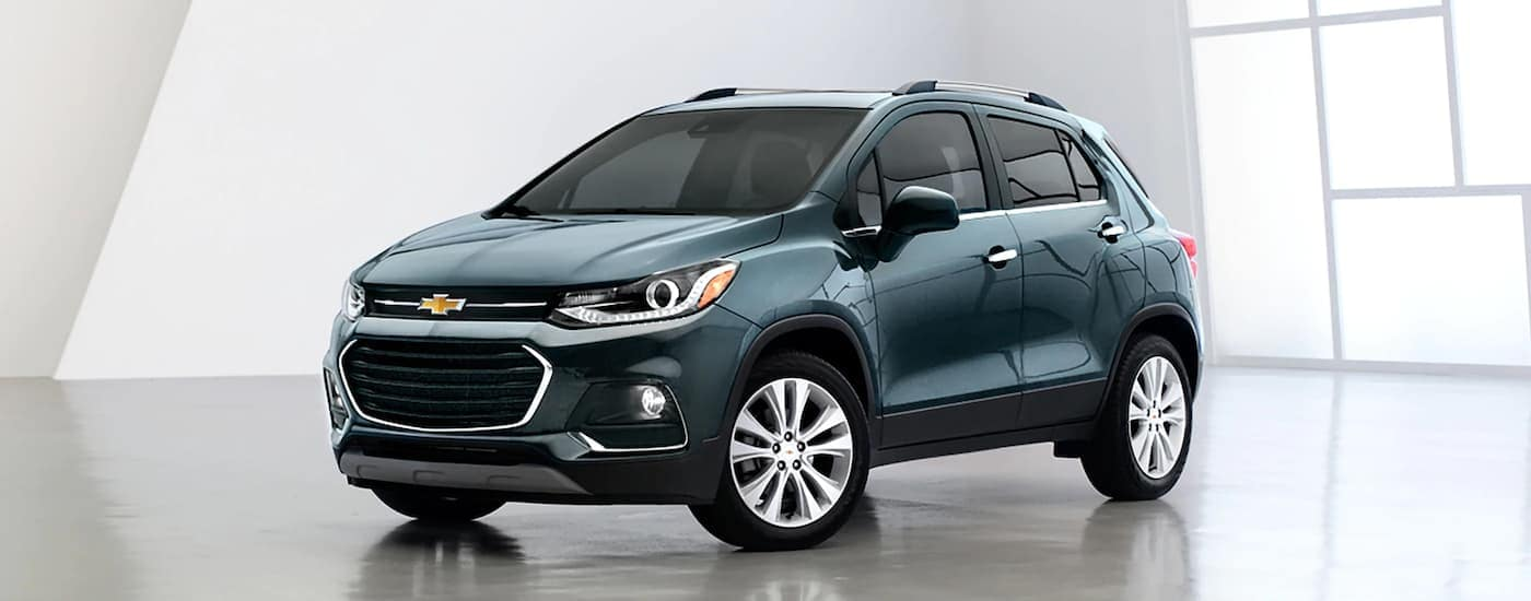 A teal 2020 Chevy Trax is sparked in a white showroom.