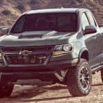 A grey 2020 Chevy Colorado ZR2 is parked off-road on a dirt trail.