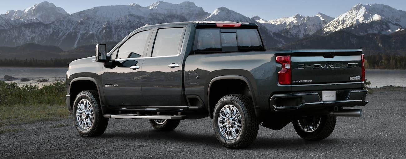A gray 2020 Chevy Silverado 2500HD High Country is parked overlooking distant mountains.