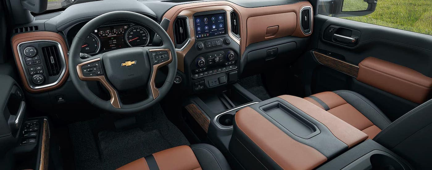 The brown and black leather interior of a 2020 Chevy Silverado 3500HD High Country is shown.