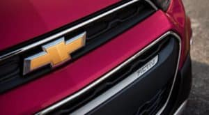 The front badging on a pink 2020 Chevy Spark ACTIV is shown.