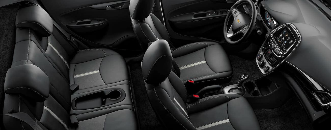 The black interior of a 2020 Chevy Spark is shown from above.
