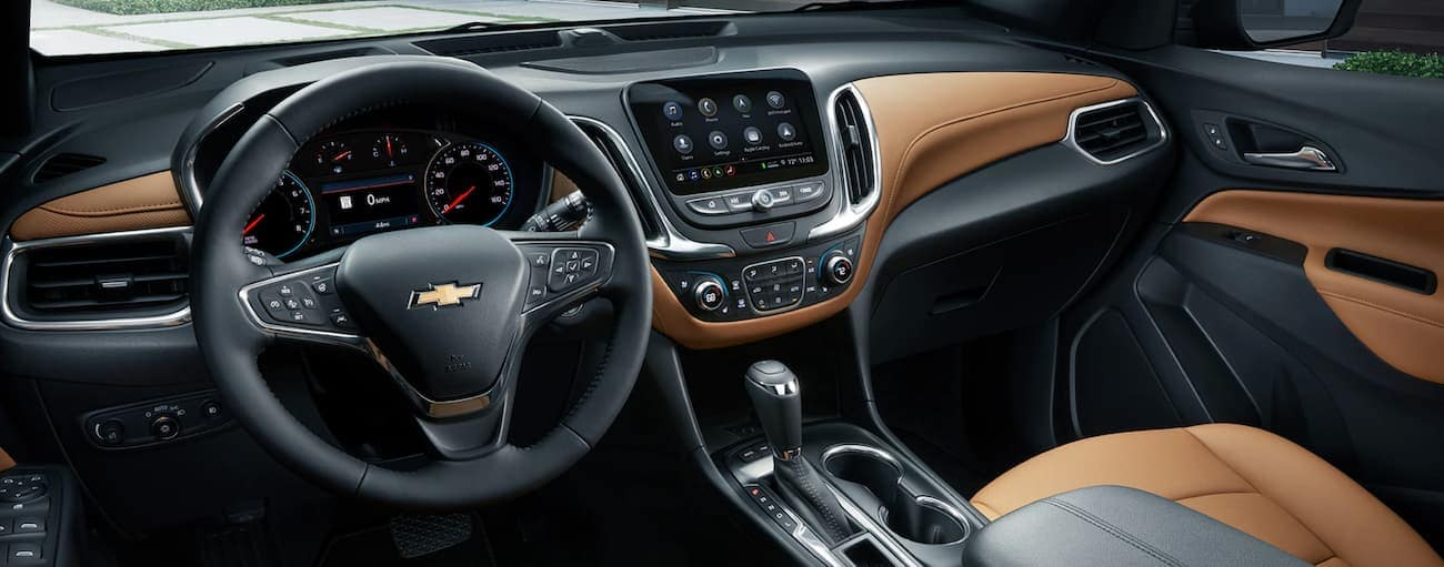 The tan and black dashboard is shown on a 2020 Chevy Equinox.