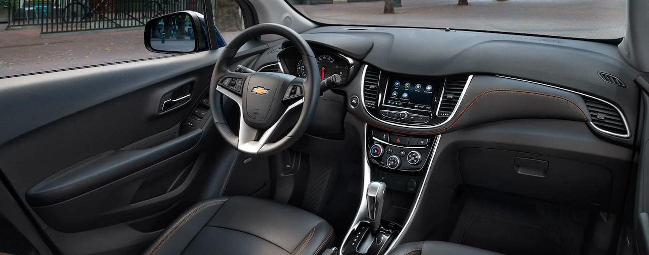 The black interior with orange stitching is shown inside a 2020 Chevy Trax.